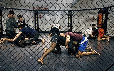People take part in a MMA (Mixed Martials Arts) training session on May 2, 2016 in Paris. (AFP / FRANCOIS GUILLOT)
