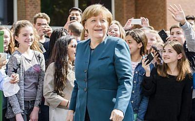 German Chancellor Angela Merkel visits the Lycee Francais School in Berlin, May 3, 2016. (AFP/CLEMENS BILAN)