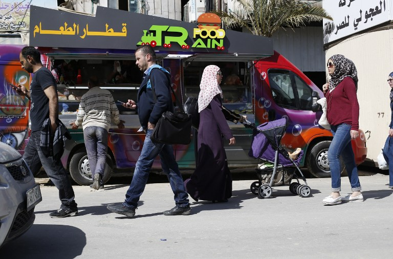 "The West Bank doesn't seem to have the same food truck ban, with the ""Food Train"" food truck of Palestinian owners al-Barghuti and al-Bibi, in the West Bank city of Ramallah May 3, 2016. (AFP/ABBAS MOMANI)"