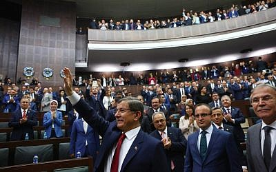 Turkish Prime Minister and leader of Turkey's ruling Justice and Development Party (AKP) Ahmet Davutoglu arrives for an AKP group meeting at the Turkish parliament in Ankara, May 3, 2016. (AFP Photo/Adem Altan)