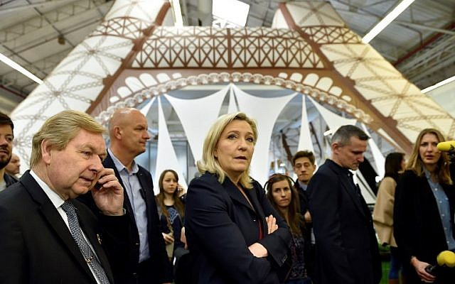 "National Front party head Marine Le Pen, center, visits a stand of the ""Concours Lepine"" at a Paris fair, May 4, 2016. (AFP/Eric Feferberg)"