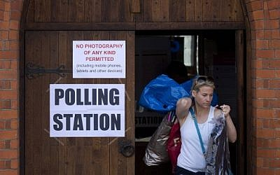 A voter leaves a polling station in a church in south London on May 5, 2016, after casting a ballot for the city's next mayor. (AFP PHOTO/JUSTIN TALLIS)