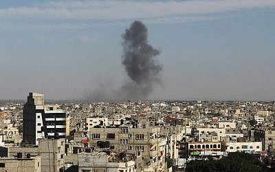 Smoke rises following an Israeli air strike in Rafah, in the southern Gaza Strip, on May 5, 2016. (AFP/Said Khatib)