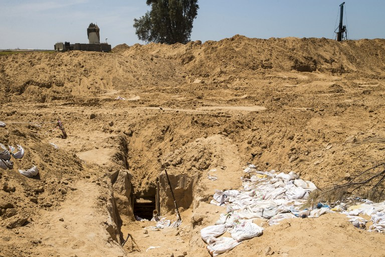 A picture taken on May 6, 2016 from the Israeli side of the border between Israel and the Gaza Strip shows the exit of a newly unearthed Hamas attack tunnel. (AFP PHOTO / JACK GUEZ)