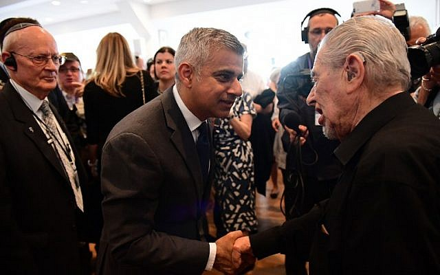 Britain's new London Mayor Sadiq Khan (C) shakes hands with Holocaust survivor Harry Fleming as he attends the Yom HaShoah Commemoration, the UK Jewish community's Holocaust remembrance ceremony, in Barnet, north London, on May 8, 2016.(AFP PHOTO / LEON NEAL)