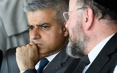The Mayor of London Sadiq Khan talks with Chief Rabbi Ephraim Mirvis of the United Congregations of the Commonwealth ahead of the Yom HaShoah Commemoration, the UK Jewish community's Holocaust remembrance ceremony, in Barnet, north London, on May 8, 2016. (AFP PHOTO / LEON NEAL)