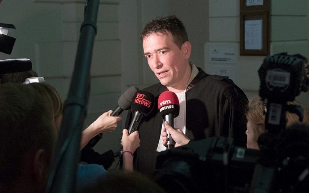 Lawyer Sebastien Courtoy talks to the press at the start of the case against the jihadist cell from Verviers, at the Brussels correctional court, on May 9, 2016. (AFP/Belga/Benoit Doppagne)