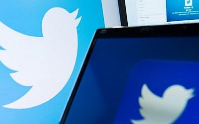 An illustrative photo taken on September 11, 2013, shows the logo of social networking website Twitter displayed on a computer screen in London. (AFP Photo/Leon Neal)