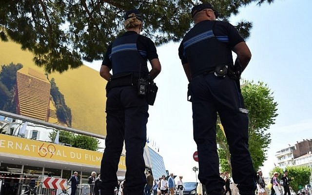 French police officers stand guard outside the Palais des Festivals in the southeastern French city of Cannes on May 10, 2016 on the eve of the opening ceremony of the 69th Cannes Film Festival. AFP/ ALBERTO PIZZOLI)