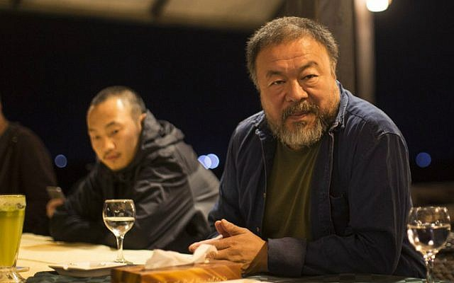 Chinese artist Ai Weiwei sits with members of his staff at the Al-Roots Hotel in Gaza City on May 11, 2016. (Mahmud Hams/AFP)