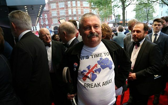 A guest poses for pictures as he arrives for the world premiere of the film 'Brexit: the Movie' in London's Leicester Square, on May 11, 2016. (Justin Tallis/AFP)