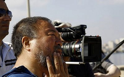 Chinese artist Ai Weiwei looks on as he meets with female university students in Gaza City on May 12, 2016 during his visit in the Gaza Strip for his upcoming documentary film on the refugee crisis in the Middle East. (AFP/ MOHAMMED ABED)