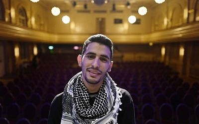 "Palestinian/Syrian refugee Ayham Ahmad, also known as ""the pianist of Yarmouk"" poses prior to a performance at Berlin's Heimathafen concert hall on May 12, 2016. / AFP PHOTO / John MACDOUGALL"