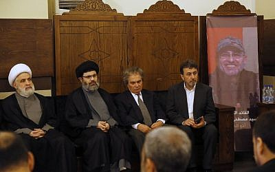 (From L-R) Lebanese Hezbollah deputy chief Sheikh Naim Qassem, head of the Hezbollah Executive Council Sayyed Hashem Safieddine, and the brothers, Annan Badreddine and Hassan Badreddine, of top Hezbollah commander Mustafa Badreddine who was killed in an attack in Syria, receive condolences in a southern suburb of Beirut, on May 13, 2016. (AFP PHOTO / ANWAR AMRO)