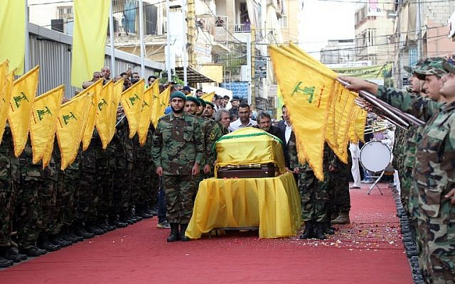 Members and supporters of Lebanon's Shiite terrorist group Hezbollah carry the coffin of Mustafa Badreddine, a top Hezbollah commander who was killed in an attack in Syria, during his funeral in the Ghobeiry neighborhood of southern Beirut on May 13, 2016. (AFP PHOTO / ANWAR AMRO)