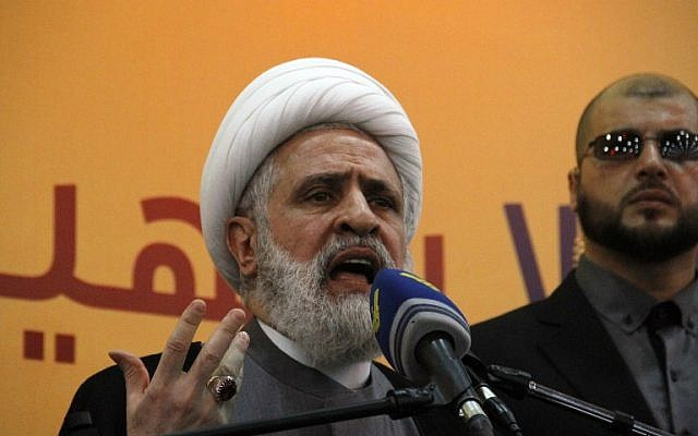 File: Hezbollah Deputy Secretary General Naim Qassem speaks in the Ghobeiry neighborhood of southern Beirut on May 13, 2016. (AFP Photo/Stringer)