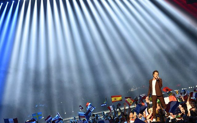 """Amir Haddad, representing France with the song """"J'ai Cherche,"""" performs during the grand final of the Eurovision Song Contest 2016 in Stockholm, on May 14, 2016. (Jonathan Nackstrand/AFP)"""