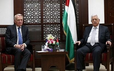 Palestinian Authority President Mahmoud Abbas, right, meets with French Foreign Minister Jean-Marc Ayrault on May 15, 2016 in the West Bank city of Ramallah. (AFP Photo/Fadi Arouri)