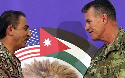 "US Major General Ralph H. Groover (R) and Jordanian Brigadier General Fahed Al-Damen shake hands following a press conference about the 2016 ""Eager Lion"" joint military exercise in Amman, on May 15, 2016. (AFP Photo/Khalil Mazraawi)"