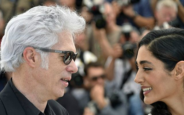 """US director Jim Jarmusch, left, and French-Iranian actress Golshifteh Farahani pose on May 16, 2016 during a photocall for the film """"Paterson"""" at the 69th Cannes Film Festival in Cannes, southern France. (Loic Venance/AFP)"""