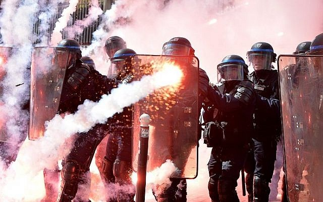 Police stand in formation as they clash with protesters at a traditional May Day demonstration