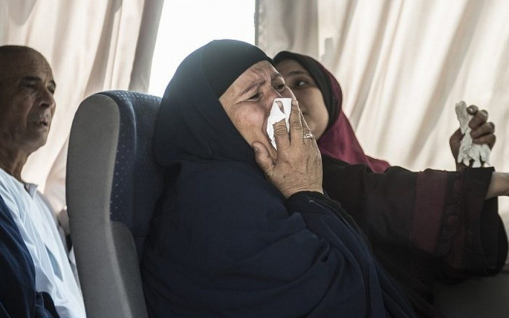 A relative of a passenger who was flying aboard an EgyptAir plane that vanished from radar en route from Paris to Cairo overnight cries as family members are transported by bus to a gathering point at Cairo airport on May 19, 2016. (AFP PHOTO / KHALED DESOUKI)