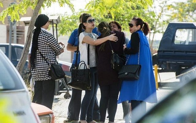 Families of passengers who were on board an EgyptAir plane that vanished from radar en route from Paris to Cairo wait outside the Cairo international airport, May 19, 2016. (AFP/Khaled Desouki)