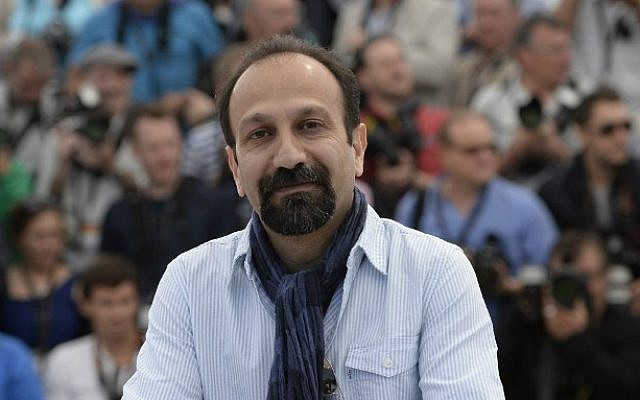 """This file photo taken on May 17, 2013 shows Iranian director Asghar Farhadi posing during a photocall for his film """"The Past"""" at the 66th Cannes Film Festival in Cannes, France. (Anne-Christine Poujoulat/AFP)"""