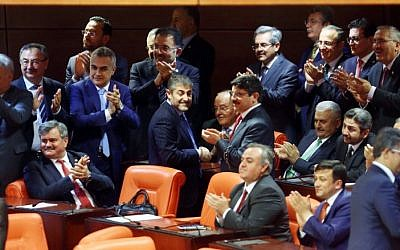 Binali Yildirim (third from right), the likely new leader of Turkey's ruling AK Party, is surrounded by his fellow MPs as he attends a debate at the Turkish parliament in Ankara on May 20, 2016. (AFP Photo/Adem Altan)