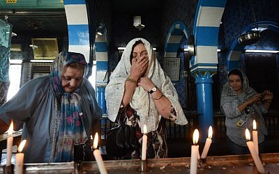 French Tunisian Jewish women pray at the Ghriba synagogue in the Tunisian resort island of Djerba during the annual Jewish Lag B'Omer pilgrimage, May 25, 2016. (AFP Photo/Fethi Belaid)