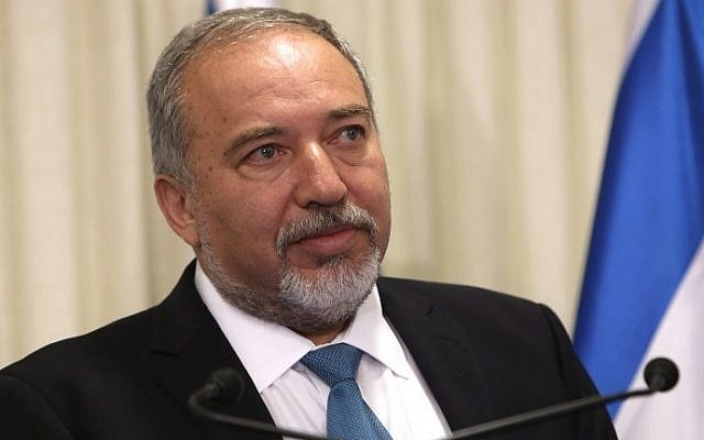 Avigdor Liberman, the head of Yisrael Beytenu party, during a ceremony in which he signed a coalition agreement with Prime Minister Benjamin Netanyahu, on May 25, 2016, at the Knesset in Jerusalem. (AFP Photo/Menahem Kahana)