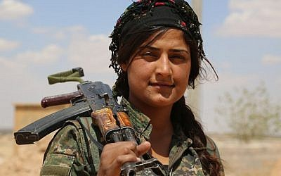 A fighter from the Kurdish People's Protection Units (YPG), part of the Syrian Democratic Forces (SDF), holds her weapon in the village of Fatisah in the northern Syrian province of Raqa on May 25, 2016. (AFP PHOTO / DELIL SOULEIMAN)