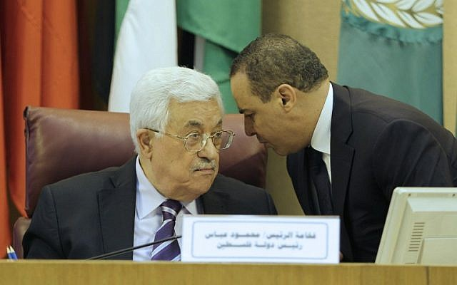 Palestinian president Mahmoud Abbas, left, during a meeting of Arab foreign ministers to discuss a French peace initiative in the Egyptian capital Cairo on May 28, 2016. (AFP/STRINGER)