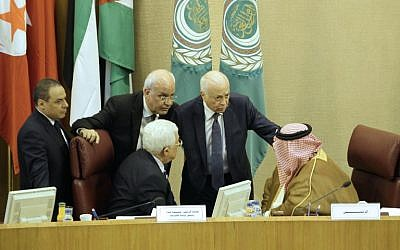 Palestinian Authority President Mahmoud Abbas (bottom left), Palestinian chief negotiator Saeb Erekat (top left), Arab League Secretary General Nabil al-Arabi (second from right) and Bahrain's Foreign Minister Khalid bin Ahmed al-Khalifa (right) speak during a meeting of Arab foreign ministers to discuss a French peace initiative in the Egyptian capital Cairo, on May 28, 2016. (AFP/Stringer)