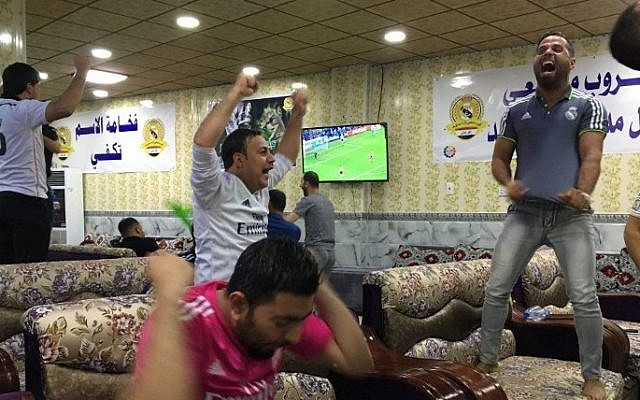 Young supporters of the Real Madrid football club  celebrate their team's victory in the Champions League final on May 28, 2016 in the Iraqi town of Balad, two weeks after their fan club was hit by a deadly shooting attack officials say left 16 people dead. (AFP)    The deadly attack was claimed by the Islamic State group and sparked an outpouring of sympathy from the football world. / AFP PHOTO / Jean-Marc Mojon