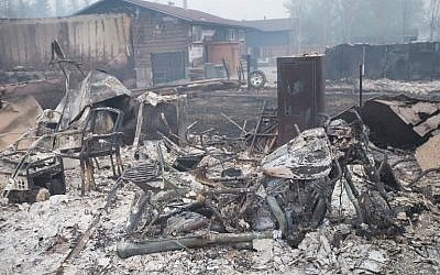 Home foundations and skeletons of possesions are all that remain in parts of a residential neighborhood destroyed by a wildfire on May 7, 2016 in Fort McMurray, Canada.(Scott Olson/Getty Images/AFP)