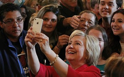 Democratic presidential candidate Hillary Clinton takes a selfie with campaign supporters after an address at a campaign rally on May 16, 2016, in Bowling Green, Kentucky. (John Sommers II/Getty Images/AFP)