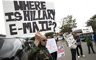 Protestors hold signs outside of a campaign rally for Hillary Clinton at Harrell College on May 25, 2016 in Riverside, California. Justin Sullivan/Getty Images/AFP)