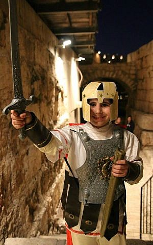 A boy dresses up in costume at Tower of David program for families with children with special needs, March 2016. (Ricky Rachman)