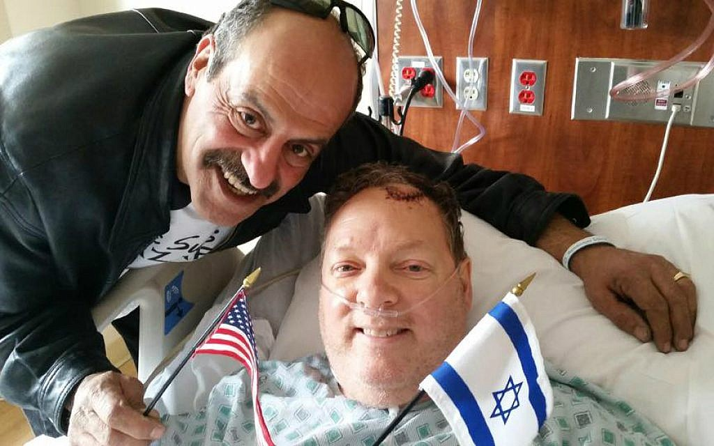 Hany Baransi (left) visits Bill Foley in hospital. Foley was seriously injured in a machete attack on Baransi's restaurant in Columbus, Ohio on February 11, 2016. (Courtesy)
