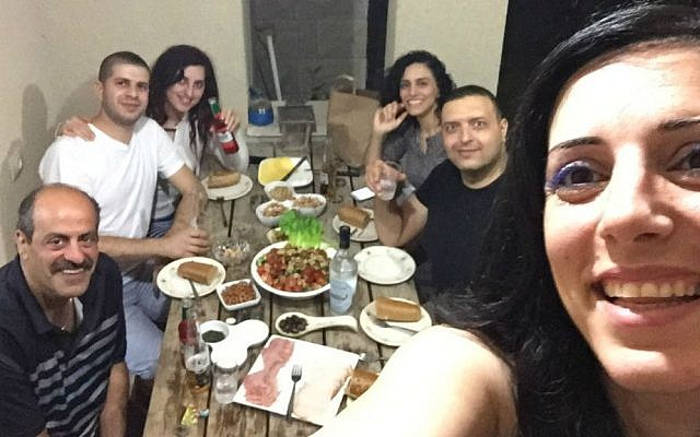 Hany Baransi (left) smiles for a selfie with relatives during his visit home to Israel in May 2016. (Courtesy)