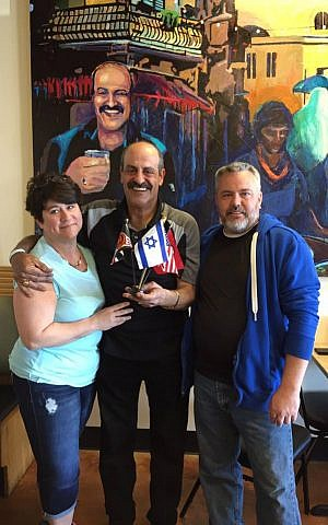 Hany Baransi (center) poses at his Nazareth Restaurant in Columbus, Ohio with a couple who recovered from injuries sustained in a machete attack at the restaurant on February 11, 2016. (Courtesy)