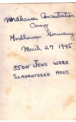 Jules Helfner's handwritten note on reverse of photo from Mittelbau-Dora concentration camp. Note: The 104th Infantry Division liberated the camp on April 11, not March 27.