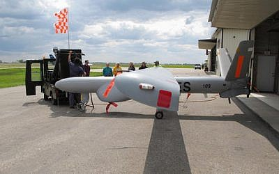 An Israeli-built Elbit Systems Hermes 450 unmanned aircraft is towed out of a hangar at the Hillsboro, North Dakota airport, where it was being used to collect agricultural data, May 20, 2016. (AP Photo/Dave Kolpack)