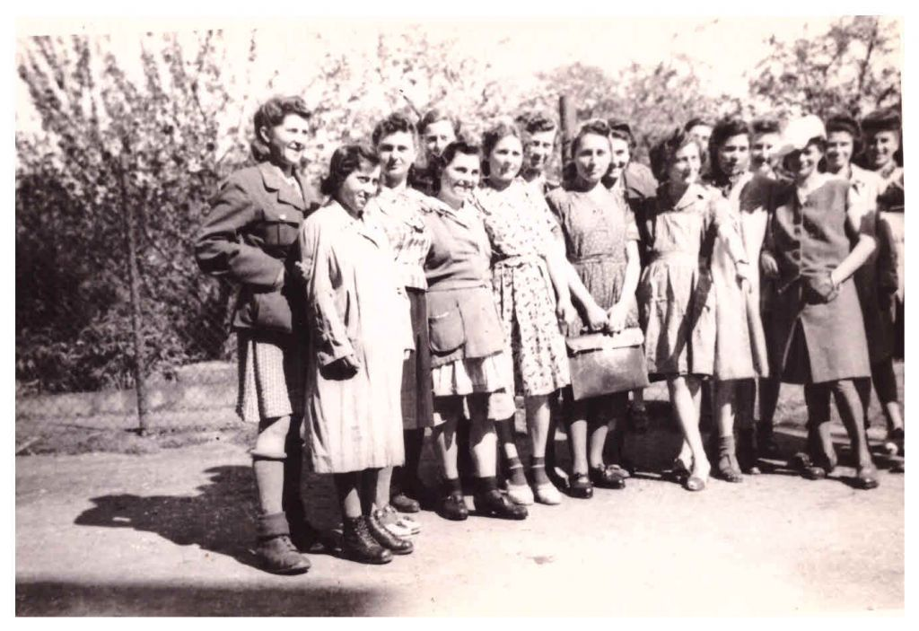 """A group of Jewish girls liberated by the 104th Inf. Div. at Wurzen, Germany. The entire group numbered 1000, most of them were Hungarians, Romanians, Polish, Russian + Austrian."" April 1945 (Jules Helfner)"