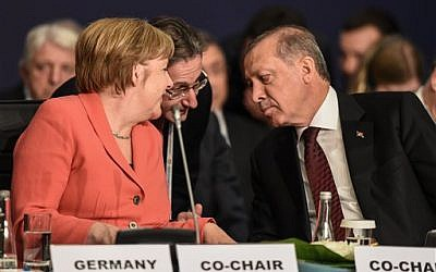 German Chancellor Angela Merkel, left, talks through an interpreter to Turkey's President Recep Tayyip Erdogan, right, during the World Humanitarian Summit in Istanbul on May 23, 2016. (Ozan Kose/Pool Photo via AP)
