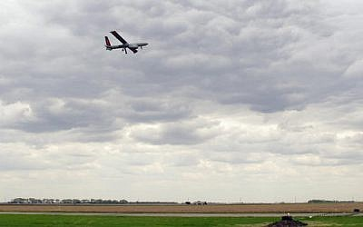 An Israeli-built Hermes 450 drone takes off from the Hillsboro, ND, airport on Friday, May 20, 2016, in its first flight to collect agriculture data in the Red River Valley. (AP Photo/Dave Kolpack)