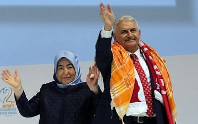 Turkey's incoming prime minister, Binali Yildirim, with his wife at an AKP party congress in Ankara, Turkey, Sunday, May 22, 2016. (AP Photo/Riza Ozel, Pool)