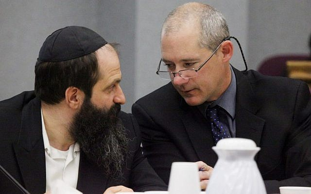 Defense attorney Montgomery Brown, right, and Sholom Rubashkin talk during the trial of Rubashkin, on state child labor charges on May 14, 2010, at the Black Hawk County Courthouse in Waterloo, Iowa. (Andrea Melendez/AP, Pool)