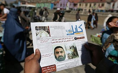 An Afghan man reads a local newspaper with photos the former leader of the Afghan Taliban, Mullah Akhtar Mansoor, who was killed in a US drone strike a week earlier, in Kabul, Afghanistan, Wednesday, May 25, 2016. (AP/Rahmat Gul)